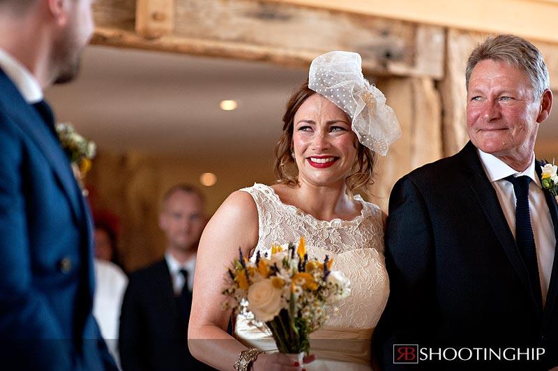Bride down the aisle at Bury Court Barn