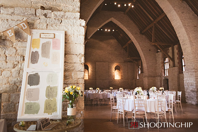 Farrow and Ball Wedding Idea Table Plan Example featuring view of Tithe Barn
