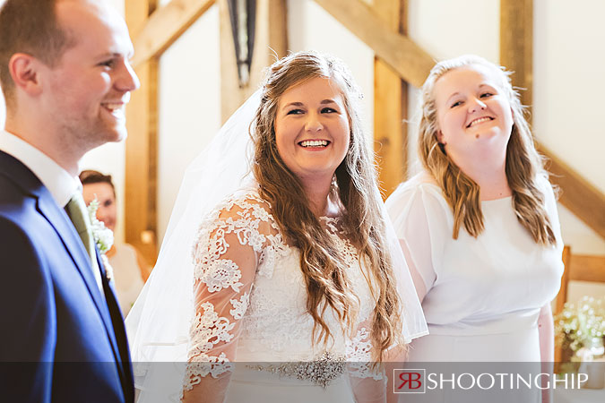 Bride laughing at Groom at Gate Street Barn