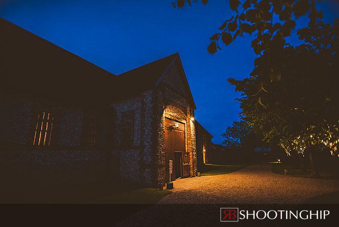 Exterior night photograph of tithe barn