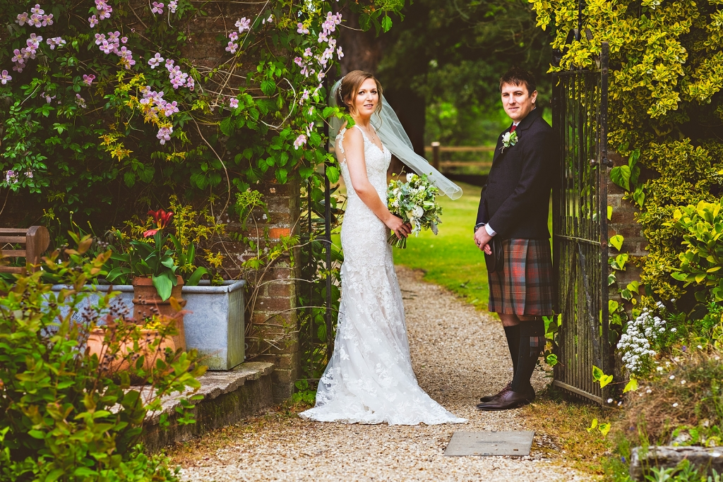 country garden bride and groom at careys manor new forest