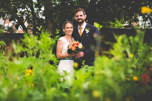 Wedding couple in a flower bed