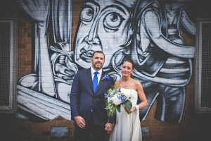 Bride and Groom with graffiti in London