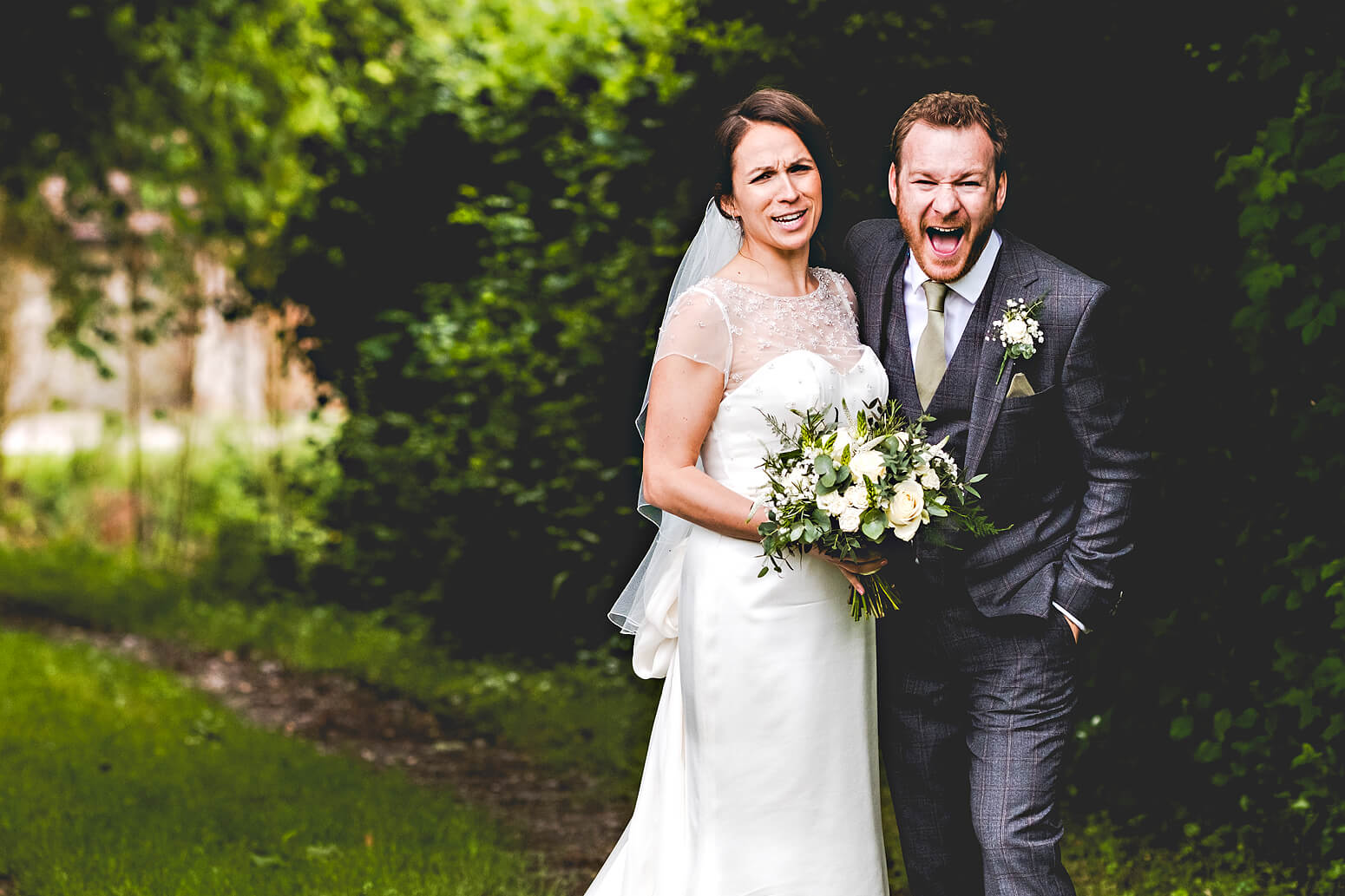 Bride and Groom laughing at Tithe Barn