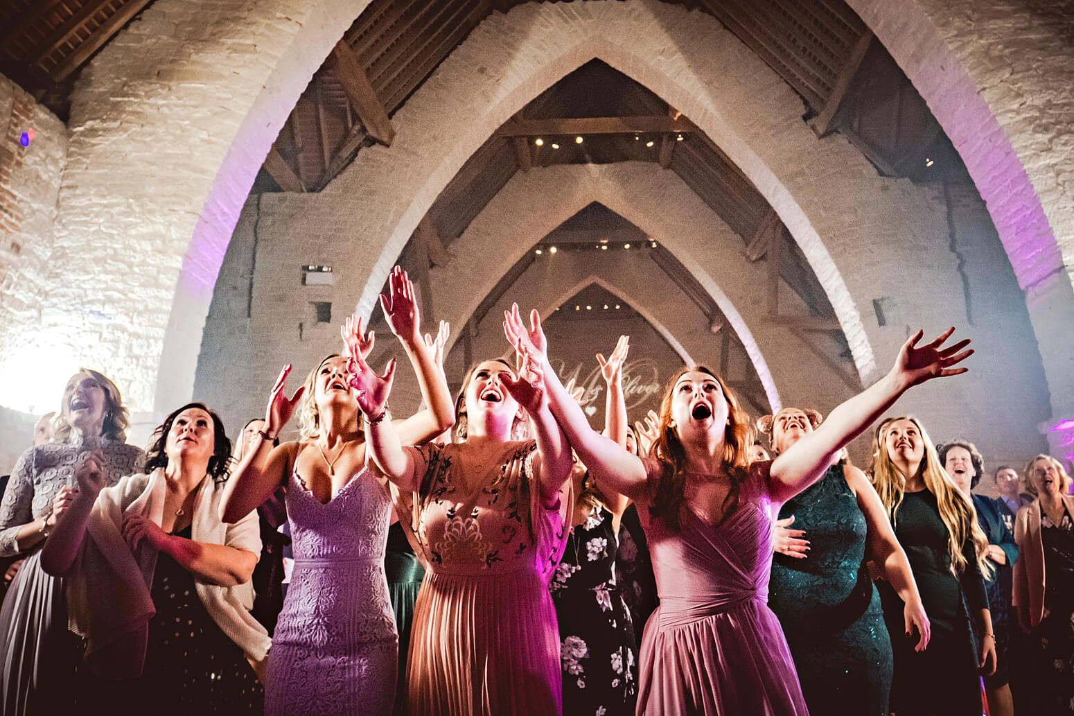 Bridal bouquet toss at Tithe Barn
