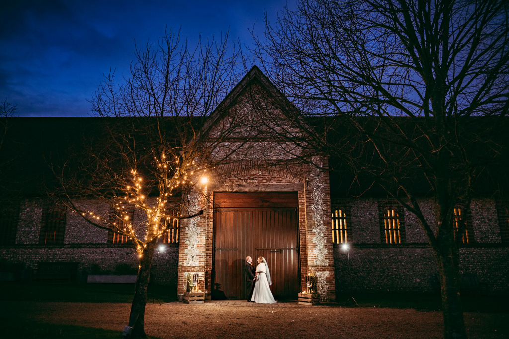 Night time couple photography at Tithe Barn