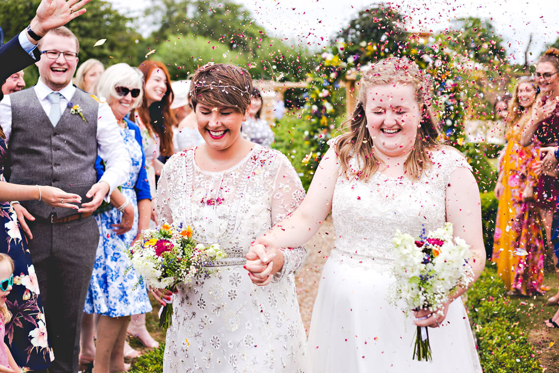 Two Brides with Confetti at the Secret Garden in Kent