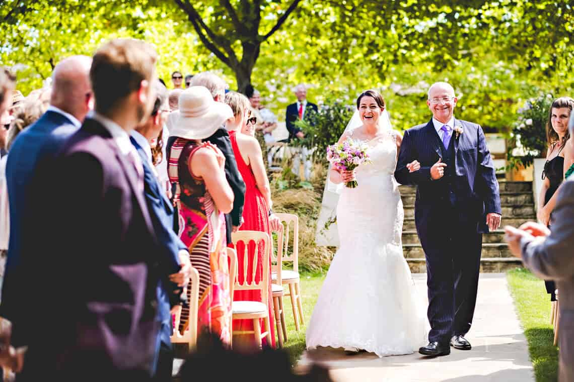Bride and Father at Outdoor Wedding Ceremony at Bury Court Barn