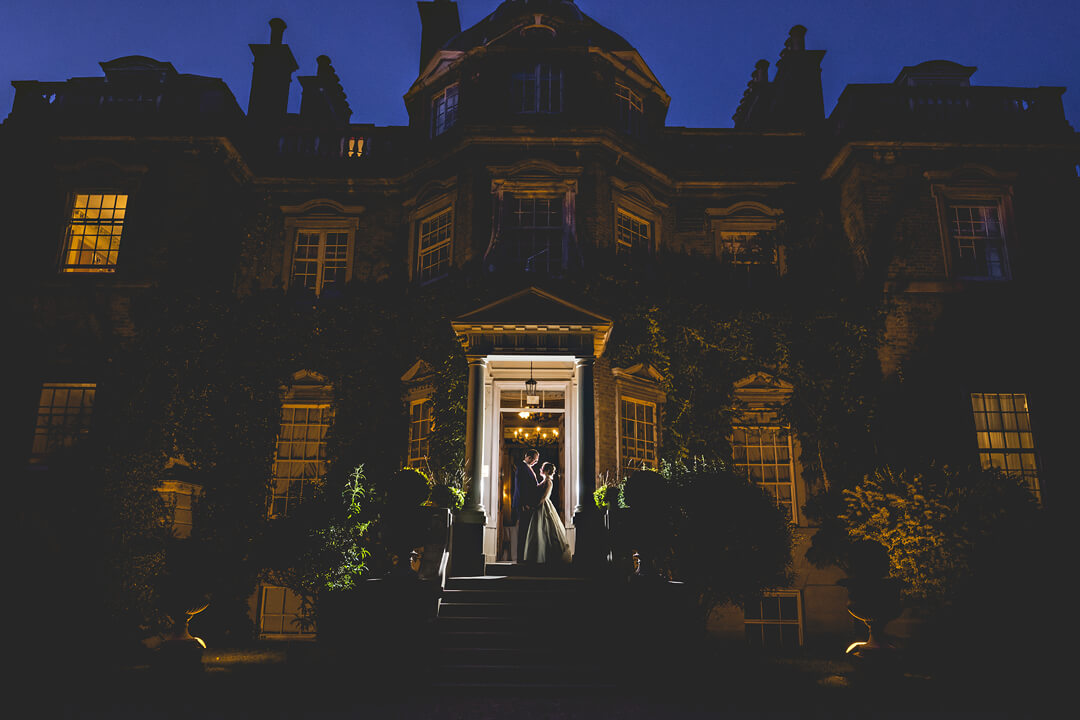 Dramatic photo of bride and groom at hampton court house