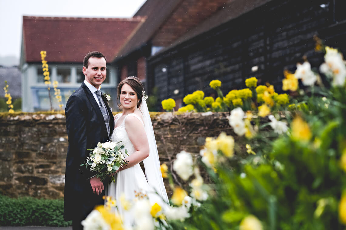 bride and groom at gate street barn