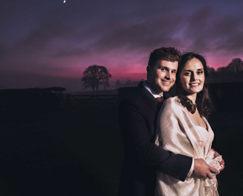 Dramatic sunset for Bride and Groom at Farbridge Barns